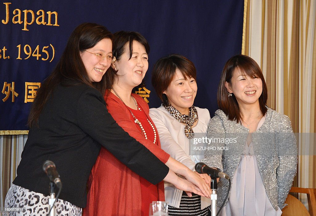 Hiroko Inokuma (2nd L), vice president of the All Japan Obachan (middle-aged and elderly women) Party, poses with fellow members during a press conference at the Foreign Correspondents' Club of Japan in Tokyo on March 14, 2013. The AJOP , which is not a formal political party but a private women's organization established as a closed group on Facebook in September 2012, now has more than 2,000 members, including university professors, journalists and housewives. AFP PHOTO / KAZUHIRO NOGI