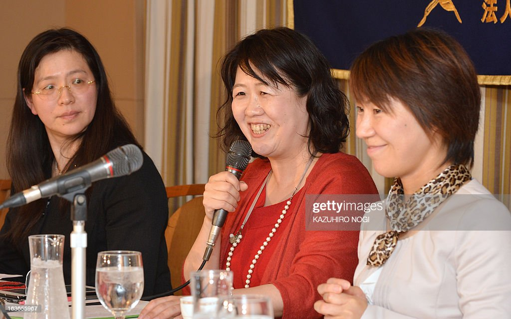 Hiroko Inokuma (C), vice president of the All Japan Obachan (middle-aged and elderly women) Party (AJOP), speaks with other members during a press conference at the Foreign Correspondents' Club of Japan in Tokyo on March 14, 2013. The AJOP , which is not a formal political party but a private women's organization established as a closed group on Facebook in September 2012, now has more than 2,000 members, including university professors, journalists and housewives.