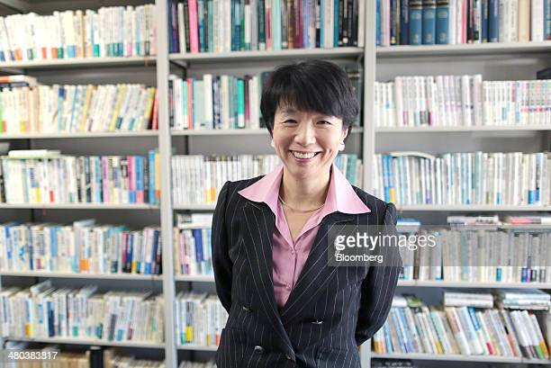 Hiroko Ota a professor of economics at the National Graduate Institute for Policy Studies poses for a photograph after an interview in Tokyo Japan on...
