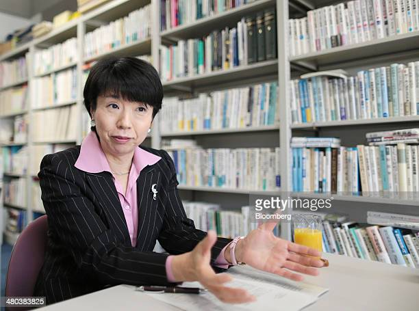 Hiroko Ota a professor of economics at the National Graduate Institute for Policy Studies gestures as she speaks during an interview in Tokyo Japan...
