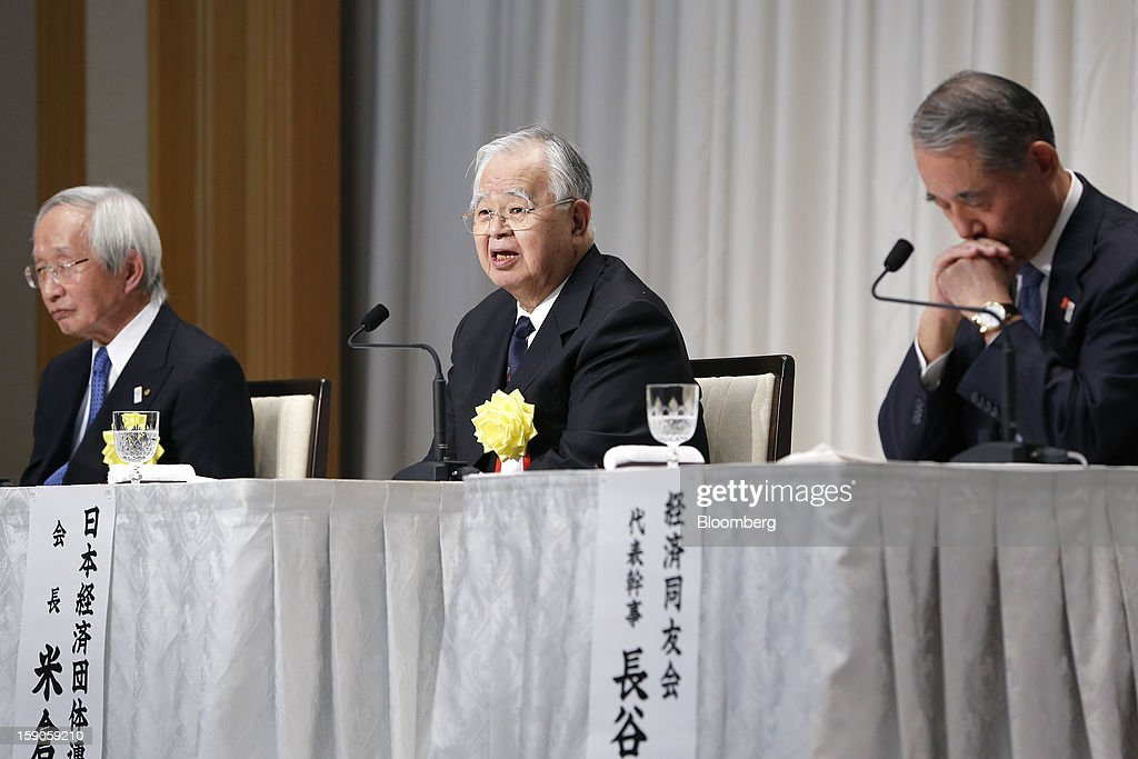 Hiromasa Yonekura, chairman of Sumitomo Chemical Co. and chairman of the business lobby Keidanren, center, speaks as Tadashi Okamura, advisor to Toshiba Corp. and chairman of the Japan Chamber of Commerce and Industry (JCCI), left, and Yasuchika Hasegawa, president of Takeda Pharmaceutical Co. and chairman of the business lobby Keizai Doyukai, listen during a news conference following a New Year's party for business leaders in Tokyo, Japan, on Monday, Jan. 7, 2013. The Japanese government will announce around 12 trillion yen ($136 billion) in fiscal stimulus measures to boost the nation's shrinking economy, Japanese media reported today. Photographer: Kiyoshi Ota/Bloomberg via Getty Images