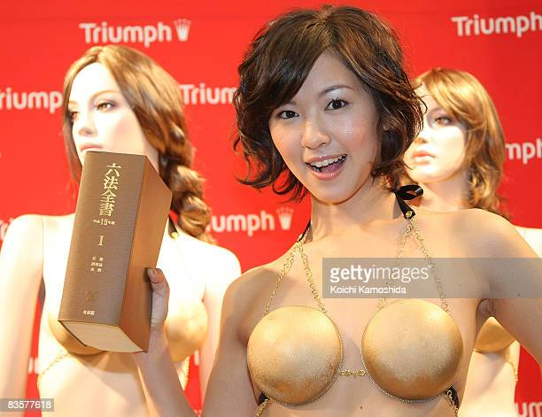 Hiromi Nishiuchi campaign girl for lingerie maker Triumph International Japan displays the 'Jury System Bra' designed as a scale and inspired by the...