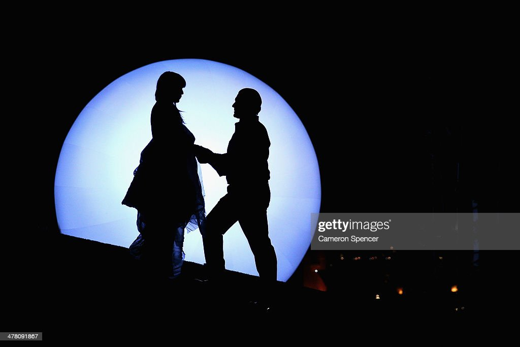 Hiromi Omura 'Madama Butterfly' and Georgy Vasiliev 'Pinkerton' perform in front of a six metre inflatable moon on the Madama Butterfly set on Sydney Harbour on March 12, 2014 in Sydney, Australia. The Opera Australia production Madama Butterfly on Sydney Harbour opens March 21.