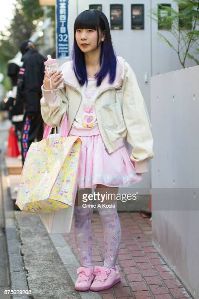 Hiromin wearing a Milkman denim bomber white and pink jacket Miracle_on pink skirt with pink stars and white stripe Puma pink shoes with pink ribbon...