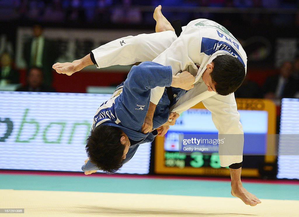 Hironori Ishikawa (L) of Japan and <a gi-track='captionPersonalityLinkClicked' href=/galleries/search?phrase=Felipe+Kitadai&family=editorial&specificpeople=7010364 ng-click='$event.stopPropagation()'>Felipe Kitadai</a> (R) of Brazil compete in the Men's 60kg semi-final during day one of the Judo Grand Slamat Yoyogi Gymnasium on November 30, 2012 in Tokyo, Japan.