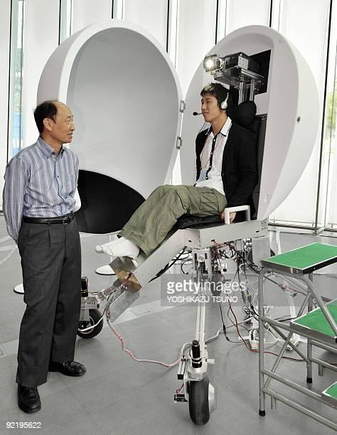 Hiroo Iwata a professor at Japan's Tsukuba University presents his virtual reality machine 'Media Vehicle' at the Digital Contents Expo in Tokyo on...