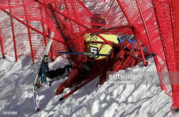Hiroomi Takizawa of Japan is tangled in the safety fence as he crashed during the semifinals in the Men's Skier X at the ESPN Winter X Games 11 on...