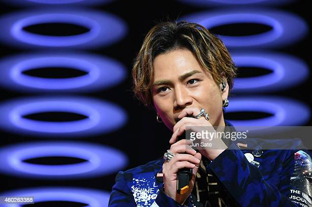 Hiroomi Tosaka of Sandaime J Soul Brothers performs on stage during the Samantha Thavasa 20th Anniversary Party at Tokyo Dome City Hall on December...