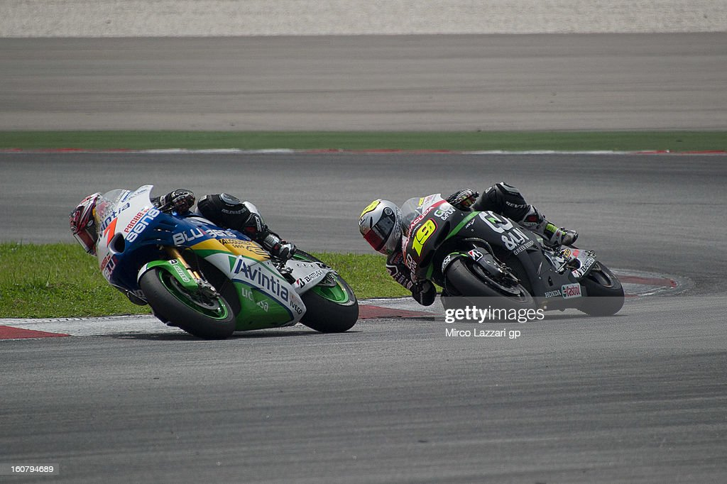 Hiroshi Aoyama of Japan and Avintia Blusens leads Alvaro Bautista of Spain and Go&Fun Honda Gresini during the MotoGP Tests in Sepang - Day Four at Sepang Circuit on February 6, 2013 in Kuala Lumpur, Malaysia.