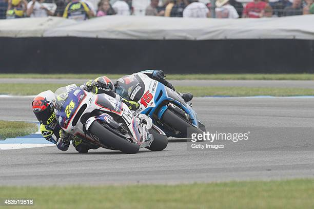 Hiroshi Aoyama of Japan leads Alex De Angelis of San Marino and EMotion Iodaracing Team during the MotoGP race during the MotoGp Red Bull US...
