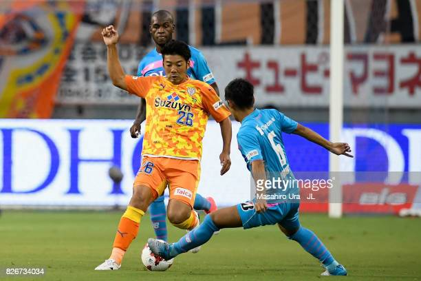 Hiroshi Futami of Shimizu SPulse and Akito Fukuta of Sagan Tosu compete for the ball during the JLeague J1 match between Sagan Tosu and Shimizu...