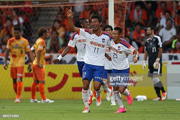 Hiroshi Ibusuki of Albirex Niigata celebrates scoring his team's first goal with his team mates during the JLeague match between Shimizu SPulse and...