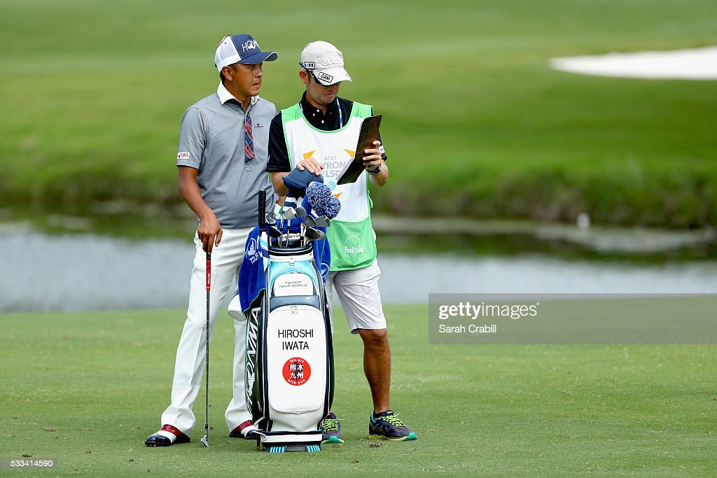 Hiroshi Iwata of Japan is seen with his caddie on the fourth hole during the Final Round at ATT Byron Nelson on May 22 2016 in Irving Texas