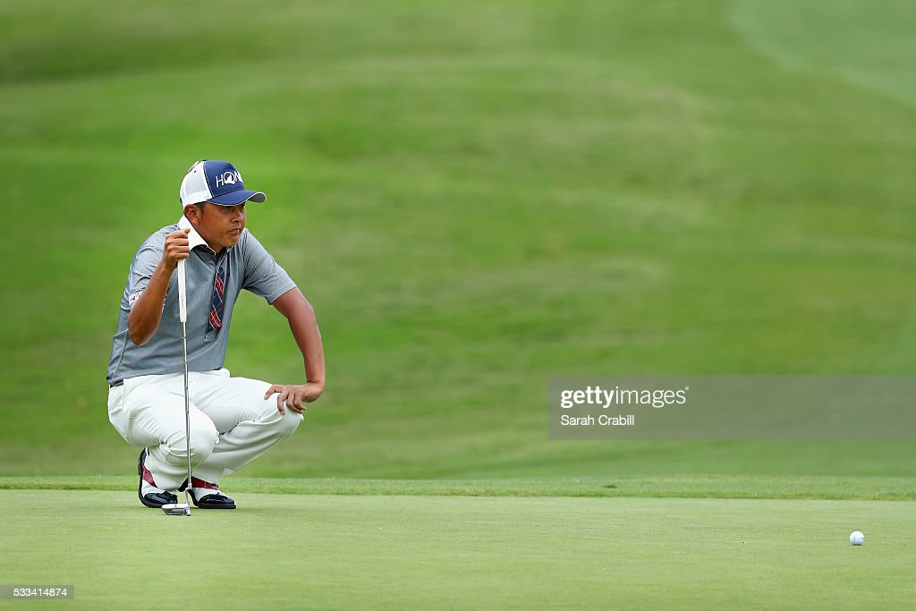 Hiroshi Iwata of Japan lines up a putt on the fourth green during the Final Round at ATT Byron Nelson on May 22 2016 in Irving Texas