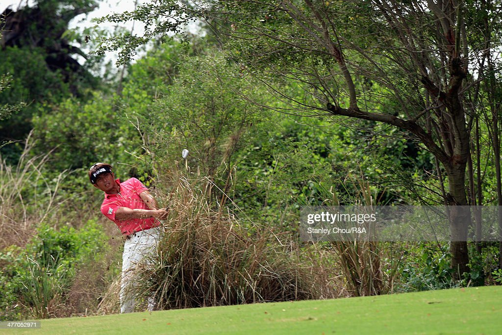 Hiroshi Iwata of Japan plays out of the rough on the 7th hole during The Open Qualifying Series Thailand 2014 at the Amata Spring Golf Club on March 7, 2014 in Bangkok, Thailand.