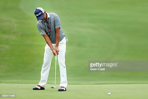 Hiroshi Iwata of Japan putts on the fourth green during the Final Round at ATT Byron Nelson on May 22 2016 in Irving Texas