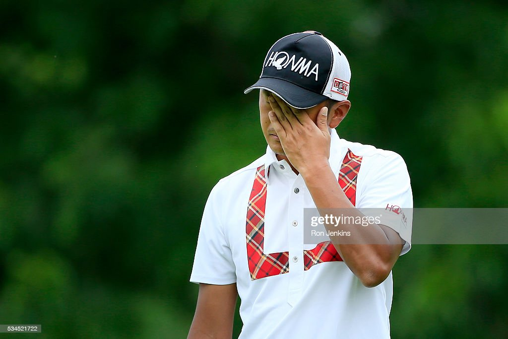 Hiroshi Iwata of Japan reacts to a putt on the second green during the First Round of the DEAN & DELUCA Invitational at Colonial Country Club on May 26, 2016 in Fort Worth, Texas.