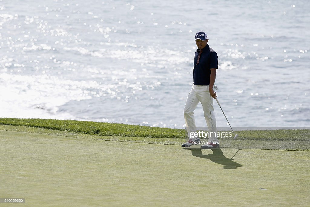 <a gi-track='captionPersonalityLinkClicked' href=/galleries/search?phrase=Hiroshi+Iwata&family=editorial&specificpeople=4696166 ng-click='$event.stopPropagation()'>Hiroshi Iwata</a> of Japan stands on the eighth green during the final round of the AT&T Pebble Beach National Pro-Am at the Pebble Beach Golf Links on February 14, 2016 in Pebble Beach, California.