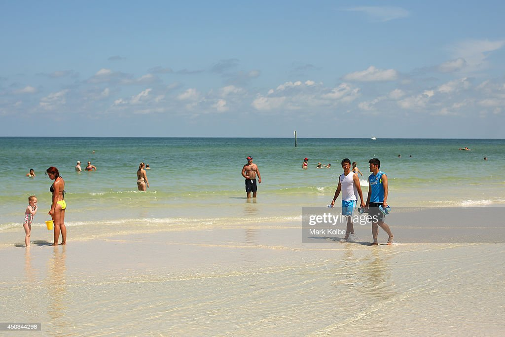 Hiroshi Kiyotake and Hotaru Yamaguchi are seen as they walk on Clearwater beach on June 6 2014 in Clearwater Florida