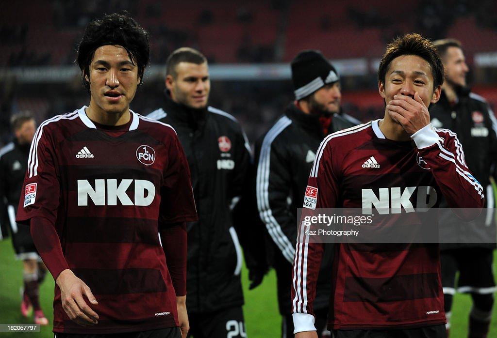 Hiroshi Kiyotake and Mu Kanazaki of 1. FC Nuernberg and Hiroki Sakai of Hannover 96 talk after the Bundesliga match between 1. FC Nuernberg and Hannover 96 at Grundig-Stadion on February 17, 2013 in Nuremberg, Germany.