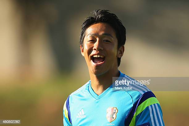 Hiroshi Kiyotake laughs during a Japan training session at the Japan national team base camp at the Spa Sport Resort on June 12 2014 in Itu Sao Paulo