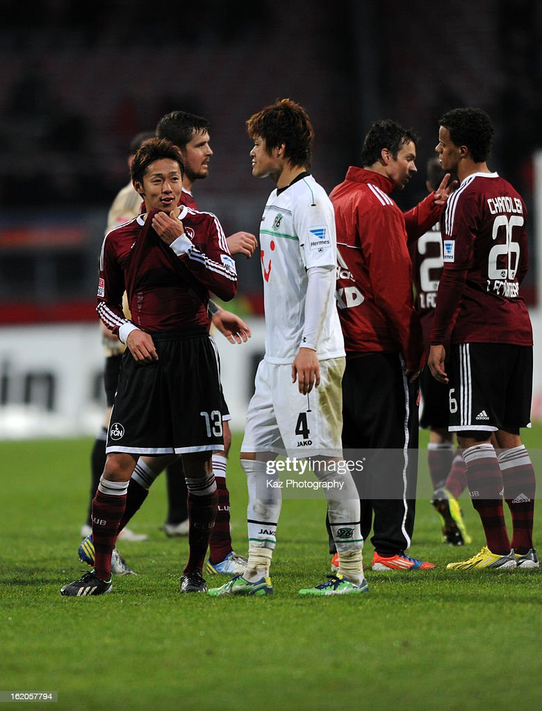 Hiroshi Kiyotake of 1. FC Nuernberg and <a gi-track='captionPersonalityLinkClicked' href=/galleries/search?phrase=Hiroki+Sakai&family=editorial&specificpeople=7728461 ng-click='$event.stopPropagation()'>Hiroki Sakai</a> of Hannover 96 talk after the Bundesliga match between 1. FC Nuernberg and Hannover 96 at Grundig-Stadion on February 17, 2013 in Nuremberg, Germany.