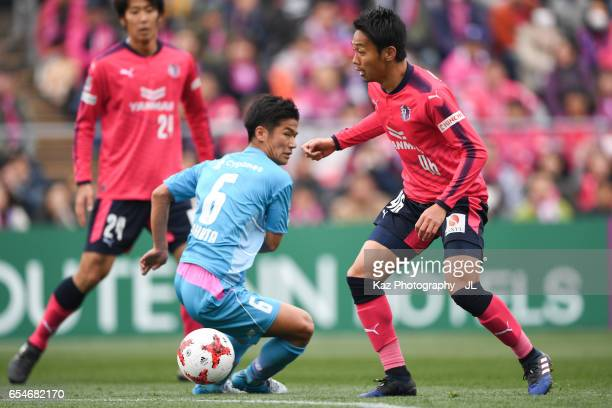Hiroshi Kiyotake of Cerezo Osaka and Akito Fukuta of Sagan Tosu compete for the ball during the JLeague J1 match between Cerezo Osaka and Sagan Tosu...