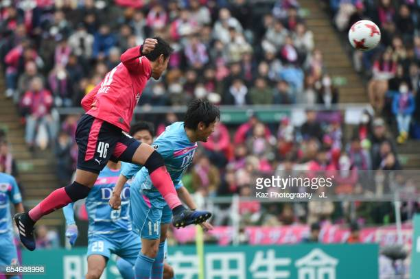 Hiroshi Kiyotake of Cerezo Osaka and Yoshiki Takahashi of Sagan Tosu compete for the ball during the JLeague J1 match between Cerezo Osaka and Sagan...