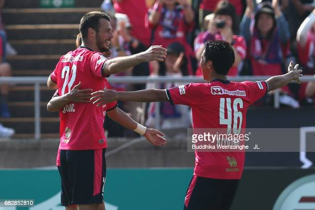 Hiroshi Kiyotake of Cerezo Osaka celebrates scoring his side's second goal with his team mates during the JLeague J1 match between Cerezo Osaka and...