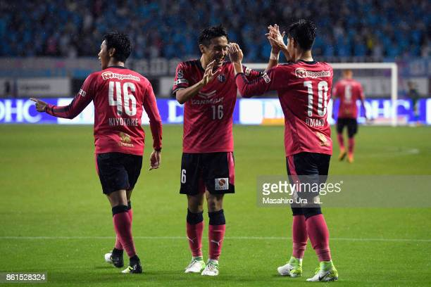 Hiroshi Kiyotake of Cerezo Osaka celebrates scoring his side's second goal with his team mates Kota Mizunuma and Hotaru Yamaguchi during the JLeague...