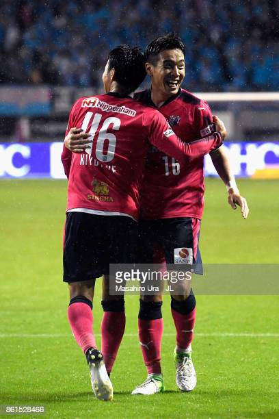 Hiroshi Kiyotake of Cerezo Osaka celebrates scoring his side's second goal with his team mate Kota Mizunuma during the JLeague J1 match between Sagan...