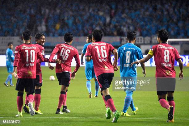 Hiroshi Kiyotake of Cerezo Osaka celebrates scoring his side's second goal with his team mates during the JLeague J1 match between Sagan Tosu and...