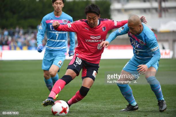 Hiroshi Kiyotake of Cerezo Osaka controls the ball under pressure of Sagan Tosu defense during the JLeague J1 match between Cerezo Osaka and Sagan...