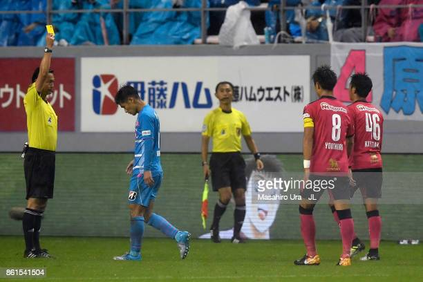 Hiroshi Kiyotake of Cerezo Osaka is shown a yellow card by referee Hajime Matsuo during the JLeague J1 match between Sagan Tosu and Cerezo Osaka at...