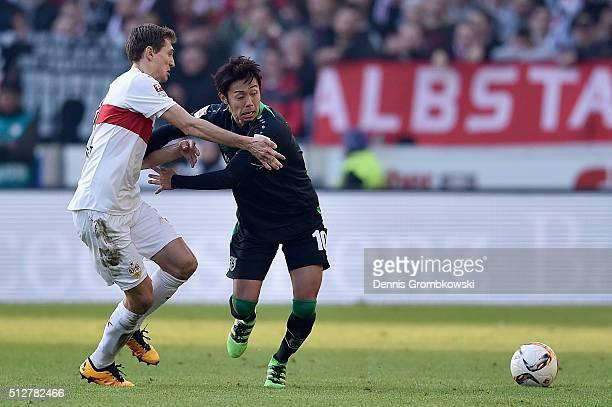 Hiroshi Kiyotake of Hannover 96 and Daniel Schwaab of VfB Stuttgart battle for the ball during the Bundesliga match between VfB Stuttgart and...