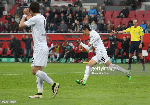 Hiroshi Kiyotake of Hannover 96 celebrates his goal next to teammate Hiroki Sakai during the Bundesliga match between FC Ingolstadt and Hannover 96...
