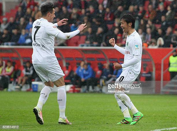 Hiroshi Kiyotake of Hannover 96 celebrates his goal with teammate Edgar Prib during the Bundesliga match between FC Ingolstadt and Hannover 96 at...