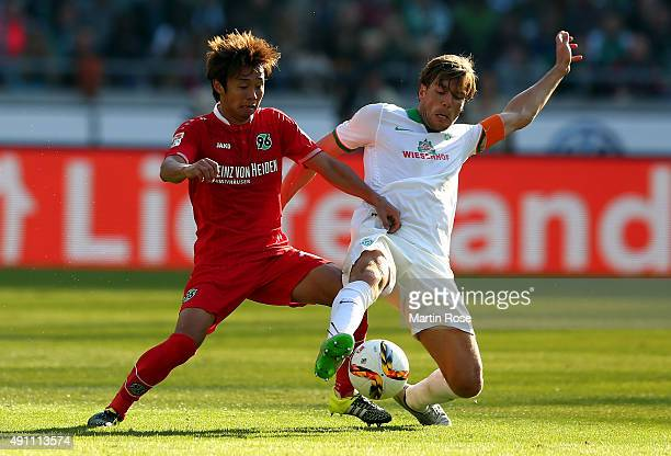 Hiroshi Kiyotake of Hannover battles for the ball with Clemens Fritz of Bremen during the Bundesliga match between Hannover 96 and Werder Bremen at...