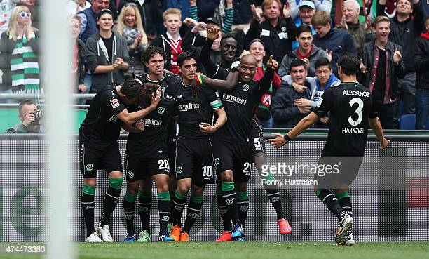 Hiroshi Kiyotake of Hannover celebrates after scoring his team's opening goal with team mates during the Bundesliga match between Hannover 96 and SC...