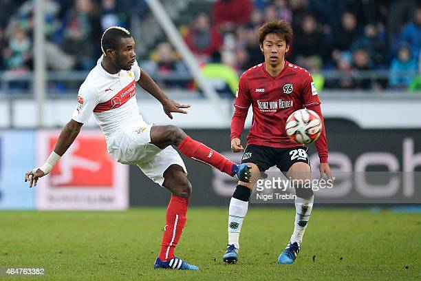 Hiroshi Kiyotake of Hannover is challenged by Die Geoffroy Serey of Stuttgart during to the Bundesliga match between Hannover 96 and VfB Stuttgart at...