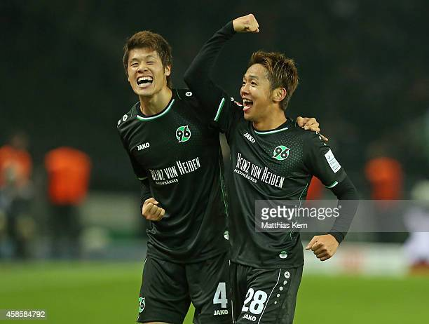 Hiroshi Kiyotake of Hannover jubilates with team mate Hiroki Sakai after scoring the second goal during the Bundesliga match between Hertha BSC and...