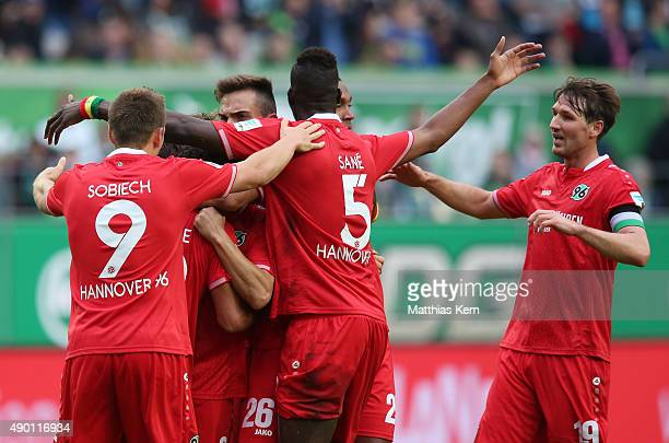 Hiroshi Kiyotake of Hannover jubilates with team mates after scoring the second goal during the Bundesliga match between VFL Wolfsburg and Hannover...