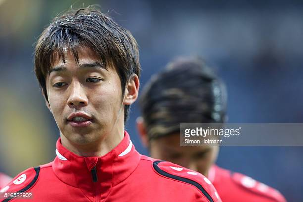 Hiroshi Kiyotake of Hannover looks on as he warms up prior to the Bundesliga match between Eintracht Frankfurt and Hannover 96 at CommerzbankArena on...