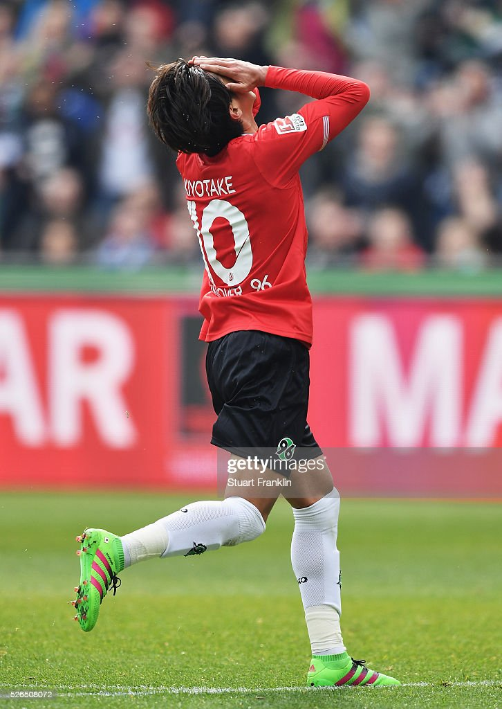 Hiroshi Kiyotake of Hannover reacts to a missed shot during the Bundesliga match between Hannover 96 and FC Schalke 04 at the HDI Arena on April 30, 2016 in Hanover, Lower Saxony.