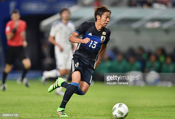 Hiroshi Kiyotake of Japan in action during the international friendly match between Japan and Bosnia and Herzegovina at the Suita City Football...