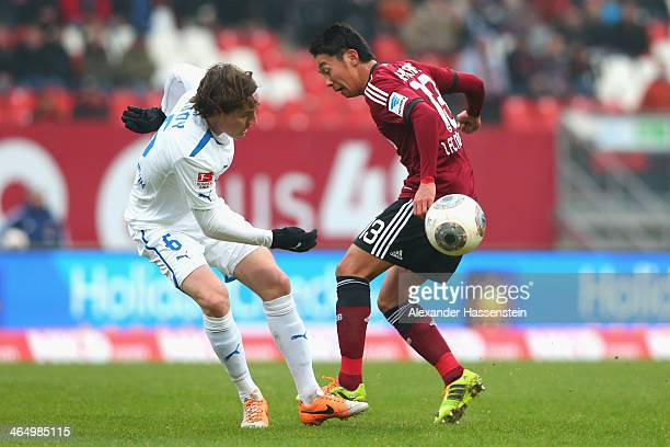 Hiroshi Kiyotake of Nuernberg battles for the ball with Sebastian Rudy of Hoffenheim during the Bundesliga match between 1 FC Nuernberg and TSG 1899...