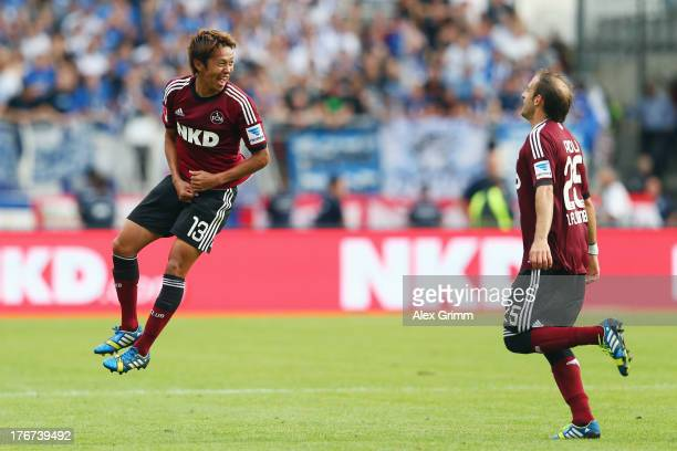 Hiroshi Kiyotake of Nuernberg celebrates his team's second goal with team mate Javier Pinola during the Bundesliga match between 1 FC Nuernberg and...