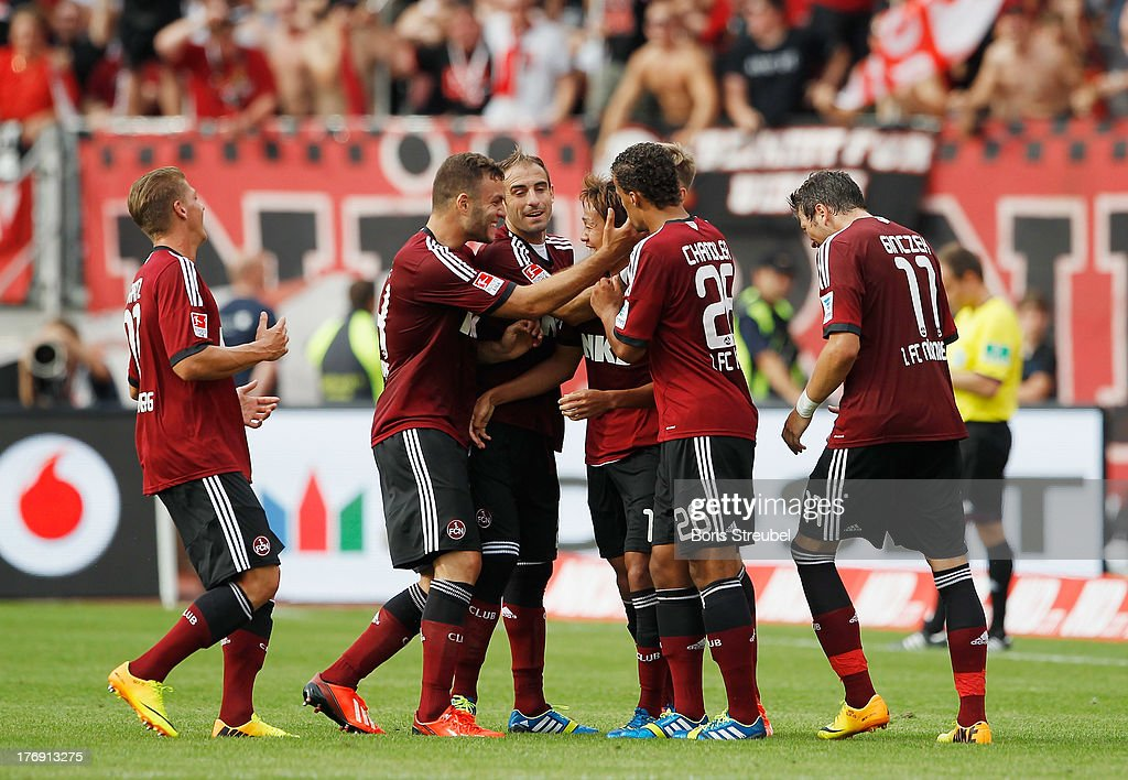 Hiroshi Kiyotake (C) of Nuernberg celebrates his team's second goal with team mates during the Bundesliga match between 1. FC Nuernberg and Hertha BSC Berlin at Grundig Stadium on August 18, 2013 in Nuremberg, Germany.