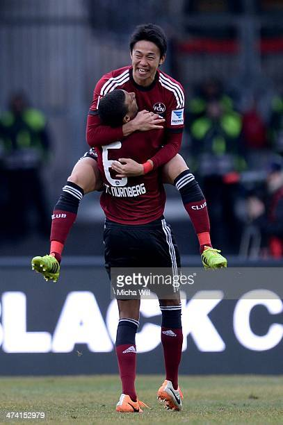 Hiroshi Kiyotake of Nuernberg celebrates with teammate Martin Angha of Nuernberg after scoring his team's first goal during the Bundesliga match...