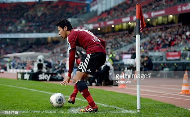 Hiroshi Kiyotake of Nuernberg places the ball for a corner kick during the Bundesliga match between 1 FC Nuernberg and VfL Wolfsburg at Grundig...